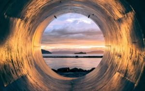 Crawl space, silver tunnel overlooking water